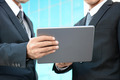 Two businessmen looking at tablet pc - PhotoDune Item for Sale