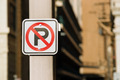 No Auto Parking Sign Bolted to Light Post Downtown - PhotoDune Item for Sale