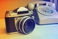 retro film camera on the wood background - PhotoDune Item for Sale