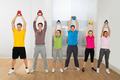 Multiethnic Friends Exercising With Kettle Bell - PhotoDune Item for Sale