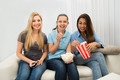 Young Women Watching Television - PhotoDune Item for Sale