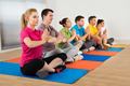 Multiethnic Group Of People Doing Meditation - PhotoDune Item for Sale