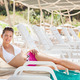 Woman In Swimwear Relaxing On Lounge Chair At Resort - PhotoDune Item for Sale