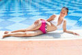Woman In Swimwear Relaxing At Poolside - PhotoDune Item for Sale