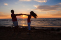 Couple Holding Hands At Beach During Sunset - PhotoDune Item for Sale
