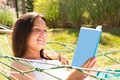 Happy Young Woman Reading Book In Hammock - PhotoDune Item for Sale