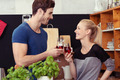 Happy Couple Having Glasses of Wine at the Kitchen - PhotoDune Item for Sale