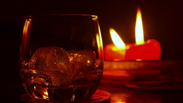 Glass Of Brandy Or Whiskey And Candles