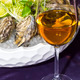 oysters on ice in a dish on a table in a restaurant - PhotoDune Item for Sale