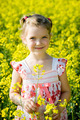 Little girl in yellow rape field - PhotoDune Item for Sale