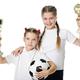 Little girls holding football ball - PhotoDune Item for Sale