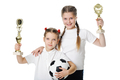 Little girls holding football ball - PhotoDune Item for Sale