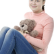 Portrait of pretty little girl holding teddy bear on white - PhotoDune Item for Sale