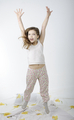 Little girl jumping on bed isolated - PhotoDune Item for Sale
