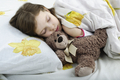 Little girl sleeping in bed with teddy bear - PhotoDune Item for Sale