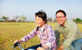 happy Father teaching child to ride bicycle - PhotoDune Item for Sale