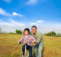 happy Father teaching his daughter to ride bicycle - PhotoDune Item for Sale