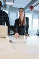 Female executive explaining business plan to her team