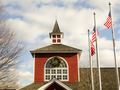red white and blue flags on a pole with american architecture - PhotoDune Item for Sale