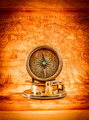 Vintage compass lies on an ancient world map. - PhotoDune Item for Sale