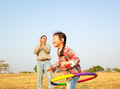 happy little girl playing  hula hoops outdoors - PhotoDune Item for Sale