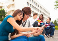 young couple student touching the smartphone - PhotoDune Item for Sale