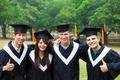 happy students in graduation gowns on university campus - PhotoDune Item for Sale