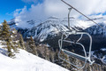 Ski Lift Chair With View of Snowy Mountains - PhotoDune Item for Sale