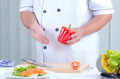 chef holding bell peper - PhotoDune Item for Sale