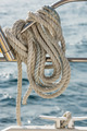 A rope tied around a rail on a yacht - PhotoDune Item for Sale