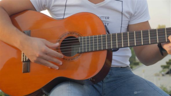 VideoHive Acoustic Guitar in City Park 10542123