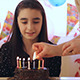 Young Girl Blowing Candles on Birthday Cake - VideoHive Item for Sale