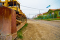 Old bulldozer on the street of north yakutian settlement Chokurd - PhotoDune Item for Sale