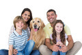 Portrait of happy family with golden retriever over white background
