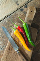 Hot peppers on wooden cutting board - PhotoDune Item for Sale