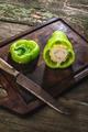 Cut green pepper on wood - PhotoDune Item for Sale