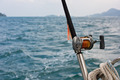 Fishing rod and reel on a boat - PhotoDune Item for Sale