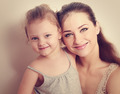 Happy smiling family. Mother and daughter. Instagram effect portrait - PhotoDune Item for Sale