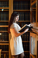 A young woman in the library - PhotoDune Item for Sale