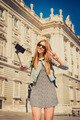 young beautiful tourist girl visiting Europe in holidays exchange students and taking selfie picture - PhotoDune Item for Sale