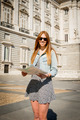 happy attractive exchange student girl visiting Madrid city reading map - PhotoDune Item for Sale