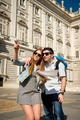 friends tourist couple visiting Madrid in holidays visiting town happy with city map - PhotoDune Item for Sale