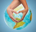 human hands showing heart shape over earth globe - PhotoDune Item for Sale