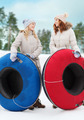 happy girl friends with snow tubes outdoors - PhotoDune Item for Sale