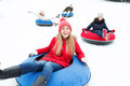 group of happy friends sliding down on snow tubes - PhotoDune Item for Sale