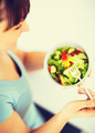 woman eating salad with vegetables - PhotoDune Item for Sale