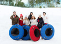 group of smiling friends with snow tubes - PhotoDune Item for Sale