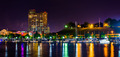 A marina and Federal Hill at night at the Inner Harbor in Baltim - PhotoDune Item for Sale
