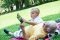 grandfather and child in park using tablet - PhotoDune Item for Sale