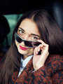 Young pretty girl sitting behind the wheel of a car - PhotoDune Item for Sale